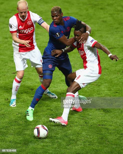 Davy Klaassen of Ajax looks on as Paul Pogba of Manchester United and Bertrand Traore of Ajax battle for possession during the UEFA Europa League...