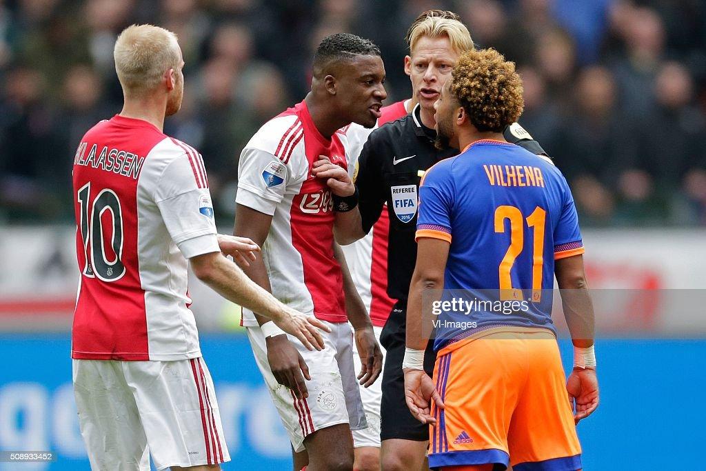 Davy Klaassen of Ajax, Riechedly Bazoer of Ajax, referee Kevin Blom, Tonny Vilhena of Feyenoord during the Dutch Eredivisie match between Ajax Amsterdam and Feyenoord Rotterdam at the Amsterdam Arena on February 07, 2016 in Amsterdam, The Netherlands