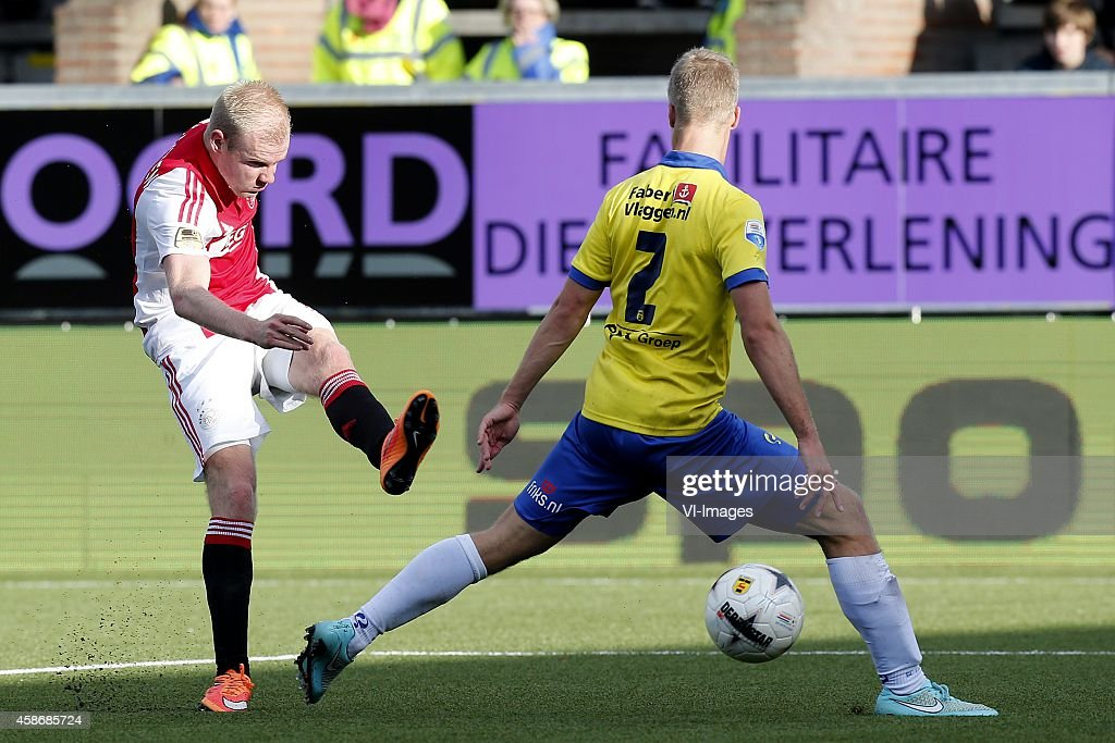 Davy Klaassen of Ajax Wout Droste of SC Cambuur during the Dutch Eredivisie match between SC Cambuur Leeuwarden and AJAX Amsterdam at the Cambuur...
