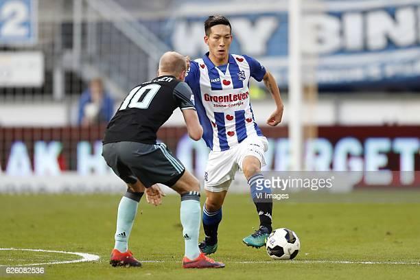 Davy Klaassen of Ajax Yuki Kobayashi of sc Heerenveenduring the Dutch Eredivisie match between sc Heerenveen and Ajax Amsterdam at Abe Lenstra...