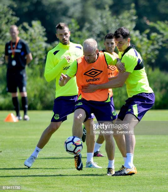 Davy Klaassen of Everton is challenged by Morgan Schneiderlin and Michael Keane during preseason training on July 18 2017 in De Lutte Netherlands