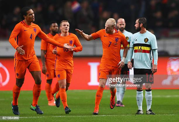 Davy Klaassen of the Netherlands celebrates with Virgil van Dijk as he scores their first goal from a penalty during the international friendly match...
