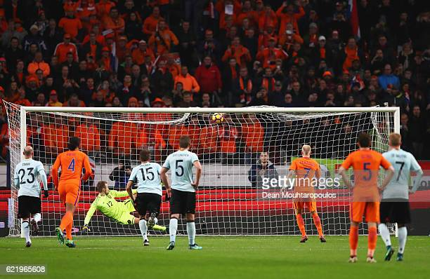 Davy Klaassen of the Netherlands scores their first goal from a penalty during the international friendly match between Netherlands and Belgium at...