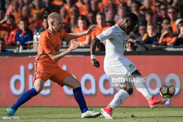 Davy Klaassen of The Netherlands Serge Aurier of Ivory Coastduring the friendly match between The Netherlands and Ivory Coast at the Kuip on June 4...
