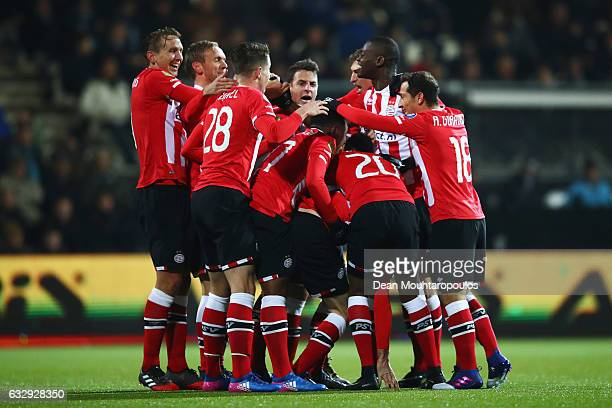 Davy Propper of PSV celebrates scoring his teams second goal of the game with team mates during the Dutch Eredivisie match between Heracles Almelo...