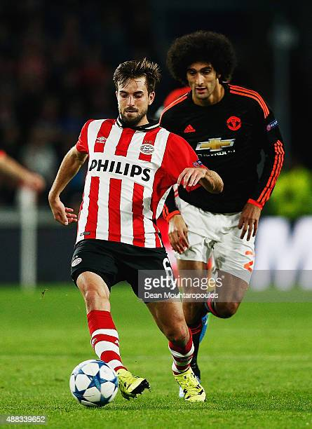 Davy Propper of PSV Eindhoven beats Marouane Fellaini of Manchester United to the ball during the UEFA Champions League Group B match between PSV...