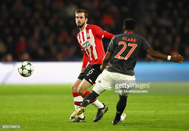 Davy Propper of PSV Eindhoven passes the ball past David Alaba of Bayern Muenchen during the UEFA Champions League Group D match between PSV...