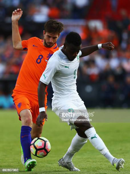 Davy Propper of the Netherlands battles for the ball with Maxwel Cornet of the Ivory Coast during the International Friendly match between the...