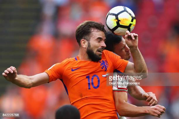 Davy Propper of the Netherlands battles for the ball with Vasil Bozhikov of Bulgaria during the FIFA 2018 World Cup Qualifier between the Netherlands...