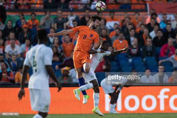 Davy Propper of The Netherlands Jean Michel Seri of Ivory Coastduring the friendly match between The Netherlands and Ivory Coast at the Kuip on June...