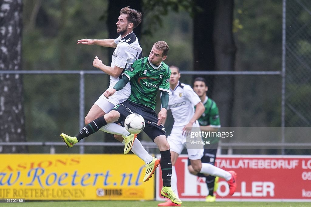 Davy Propper of Vitesse, Stephen Buyl of Cercle Brugge during the friendly match between Vitesse and Cercle Brugge on July 4, 2014 at Sportpark Loenermark at Loenen, The Netherlands.