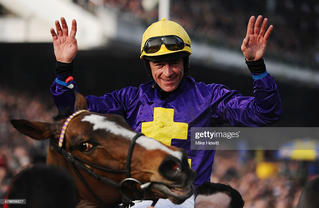 Davy Russell on Lord Windermere celebrates winning the Betfred Cheltenham Gold Cup Chase during the Cheltenham Festival at Cheltenham Racecourse on March 14, 2014 in Cheltenham, England.