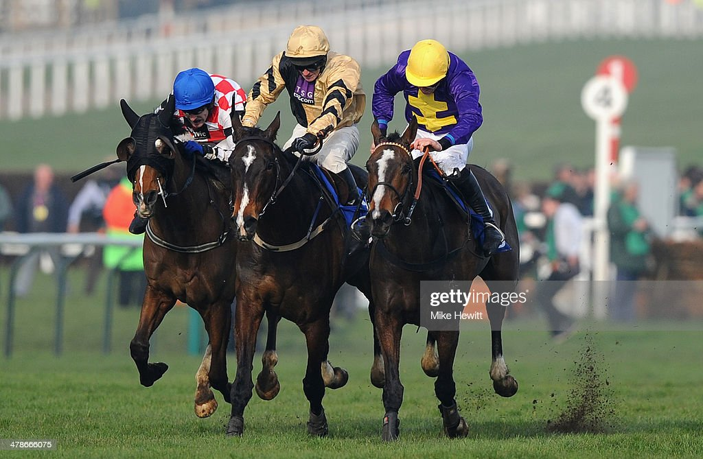 Davy Russell on Lord Windermere (R) win from <a gi-track='captionPersonalityLinkClicked' href=/galleries/search?phrase=David+Casey&family=editorial&specificpeople=224375 ng-click='$event.stopPropagation()'>David Casey</a> on On His Own (centre) and Tom Scudamore on The Giant Bolster during the Cheltenham Festival at Cheltenham Racecourse on March 14, 2014 in Cheltenham, England.