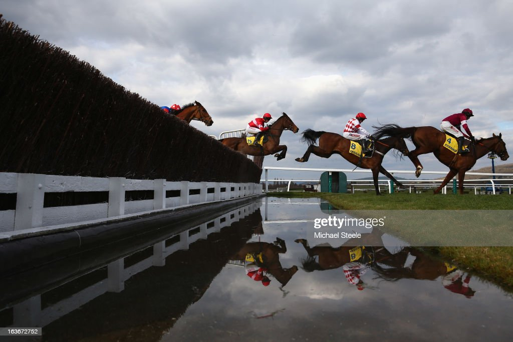 Davy Russell (R) riding First Lieutenant leads the field over the water jump during the Ryanair Steeple Chase race on St Patrick's Thursday at Cheltenham Racecourse on March 14, 2013 in Cheltenham, England.