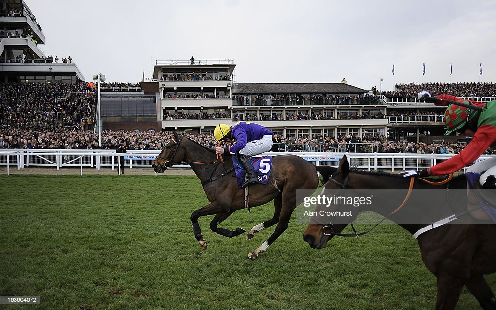 Davy Russell riding Lord Windermere (L) clear the last to win The RSA Steeple Chase from Lyreen Legend (R) during Ladies Day at Cheltenham racecourse on March 13, 2013 in Cheltenham, England.