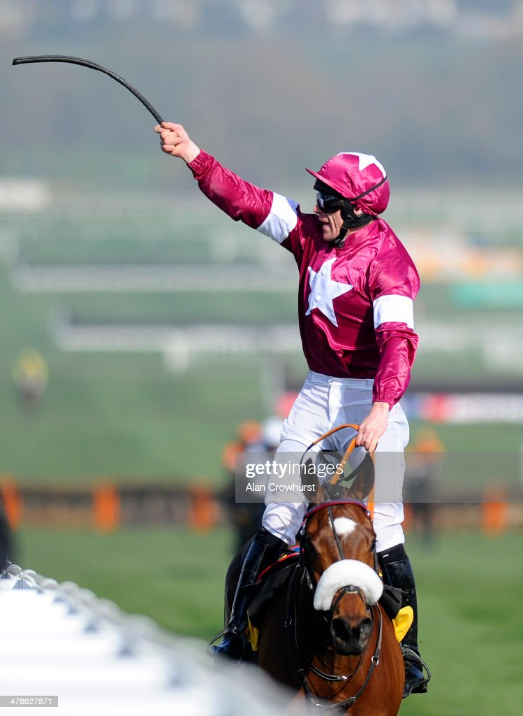 Davy Russell riding Tiger Roll celebrate winning The JCB Triumph Hurdle Race during Cheltenham Gold Cup day at the Cheltenham Festival at Cheltenham racecourse on March 14, 2014 in Cheltenham, England.