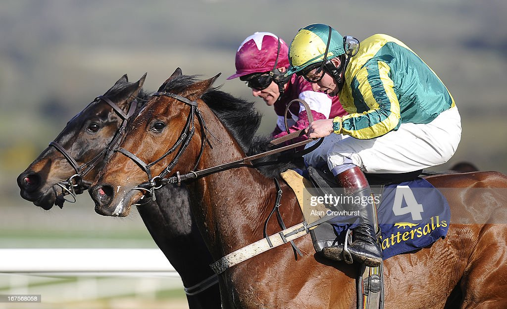 Davy Russell riding Un Atout (L) clear the last to win The Tattersalls Ireland Champion Novice Hurdle from Ubak (R) at Punchestown racecourse on April 26, 2013 in Naas, Ireland.