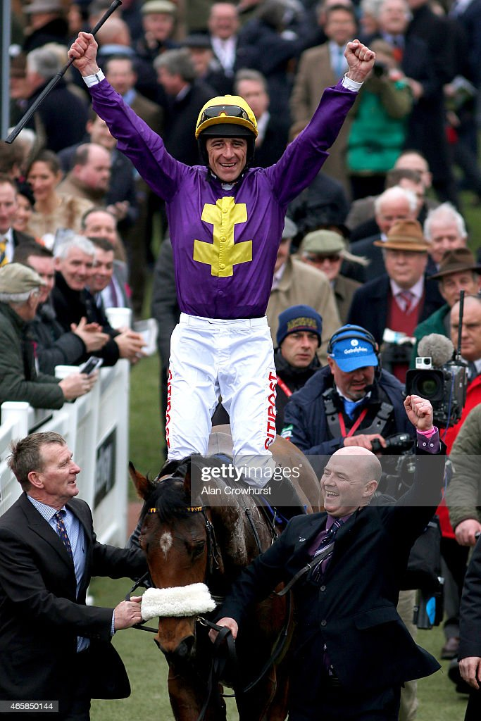 Davy Russell riding Windsor Park celebrate winning The Neptune Investment Management Novices' Hurdle Race at Cheltenham racecourse on March 11 2015...