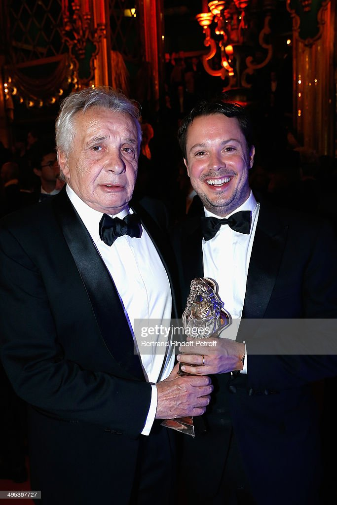 Davy Sardou (R), winner of the Moliere of the Actor in a Supporting Role for 'L'Affrontement' poses with his father Michel Sardou (L) after the 26th Molieres Awards Ceremony at Folies Bergere on June 2, 2014 in Paris, France.