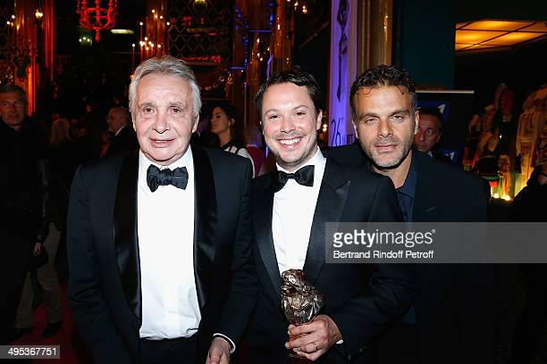 Davy Sardou winner of the Moliere of the Actor in a Supporting Role for 'L'Affrontement' poses with his father Michel Sardou and Steve Suissa after...