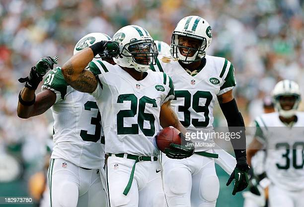 Dawan Landry of the New York Jets celebrates an interception against the Tampa Bay Buccaneers with teammate Antonio Allen on September 8 2013 at...