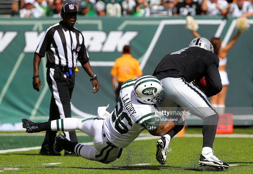<a gi-track='captionPersonalityLinkClicked' href=/galleries/search?phrase=Dawan+Landry&family=editorial&specificpeople=575013 ng-click='$event.stopPropagation()'>Dawan Landry</a> #26 of the New York Jets sacks <a gi-track='captionPersonalityLinkClicked' href=/galleries/search?phrase=Derek+Carr&family=editorial&specificpeople=8222798 ng-click='$event.stopPropagation()'>Derek Carr</a> #4 of the Oakland Raiders during the third quarter at MetLife Stadium on September 7, 2014 in East Rutherford, New Jersey.