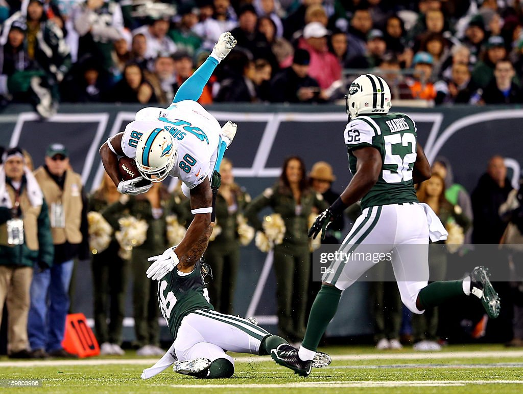 <a gi-track='captionPersonalityLinkClicked' href=/galleries/search?phrase=Dawan+Landry&family=editorial&specificpeople=575013 ng-click='$event.stopPropagation()'>Dawan Landry</a> #26 of the New York Jets tackles <a gi-track='captionPersonalityLinkClicked' href=/galleries/search?phrase=Dion+Sims&family=editorial&specificpeople=6234903 ng-click='$event.stopPropagation()'>Dion Sims</a> #80 of the Miami Dolphins after a catch in the first half during their game at MetLife Stadium on December 1, 2014 in East Rutherford, New Jersey.