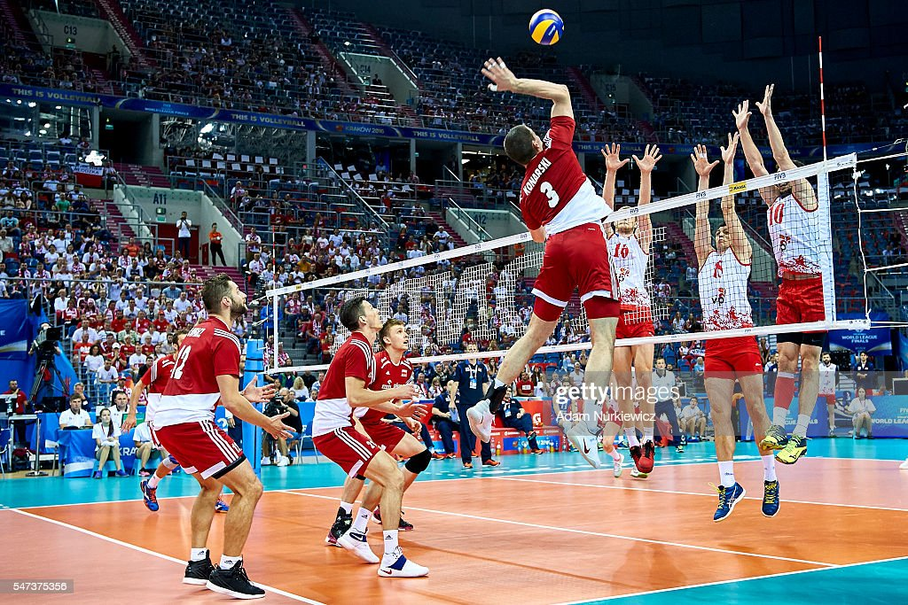 Dawid Konarski from Poland attacks against Drazen Luburic from Serbia and Marko Podrascanin from Serbia and Milos Nikic from Serbia while the FIVB...