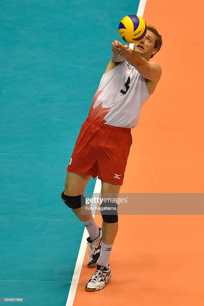 Dawid Konarski #3 of Poland tosses the ball during the Men's World Olympic Qualification game between Poland and Canada at Tokyo Metropolitan Gymnasium on May 28, 2016 in Tokyo, Japan.