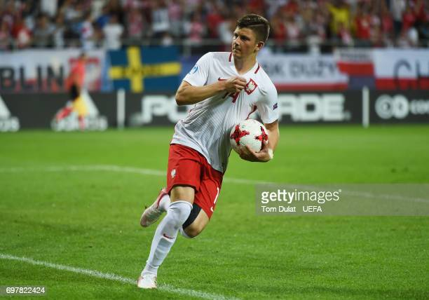 Dawid Kownacki of Poland celebrates scoring his late penalty during the UEFA European Under21 Championship Group A match between Poland and Sweden at...