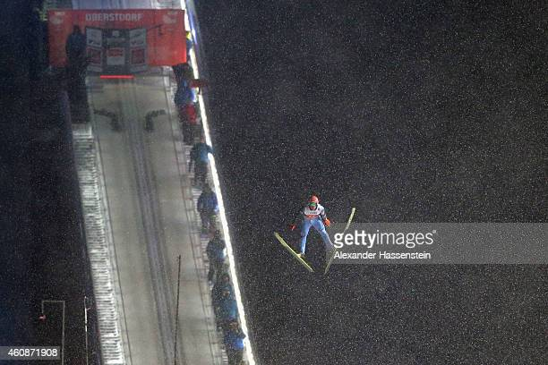 Dawid Kubacki of Poland competes on day 2 of the Four Hills Tournament Ski Jumping event at SchattenbergSchanze Erdinger Arena on December 28 2014 in...