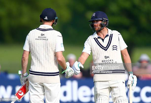 Dawid Malan and Adam Voges of Middlesex congratulate each other during day one of the Specsavers County Championship Division One match between...