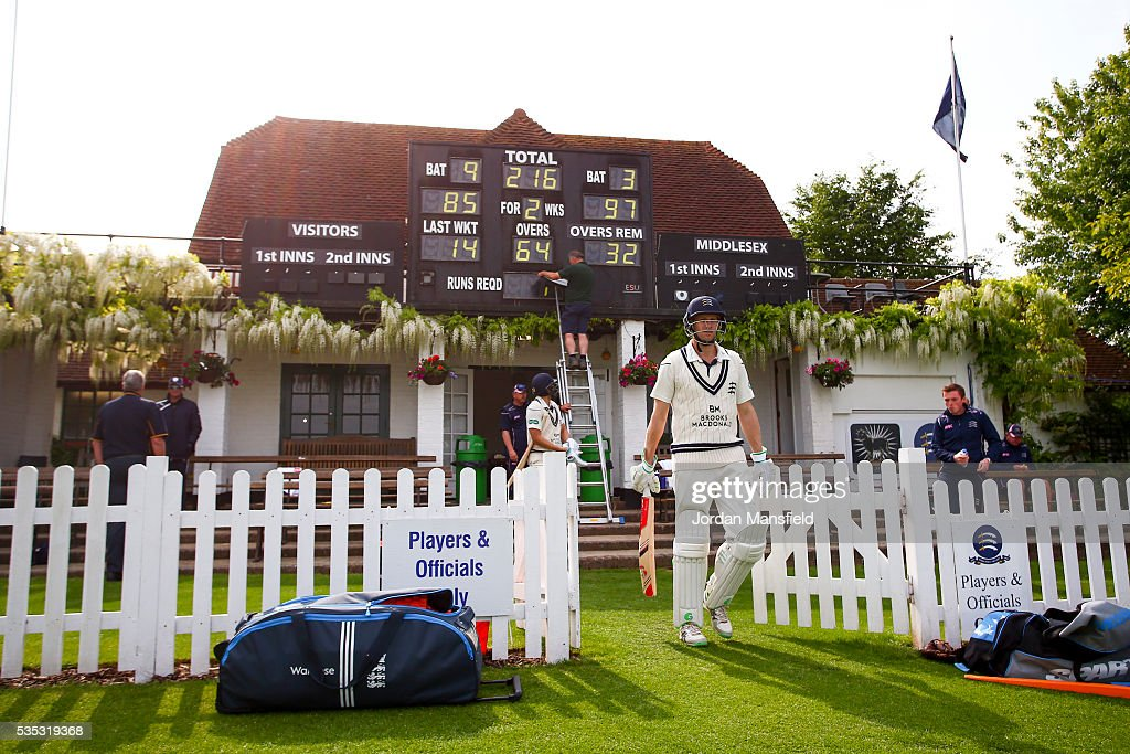 <a gi-track='captionPersonalityLinkClicked' href=/galleries/search?phrase=Dawid+Malan&family=editorial&specificpeople=4250352 ng-click='$event.stopPropagation()'>Dawid Malan</a> and Adam Voges of Middlesex make their way out onto the field after tea after he reaches his century during day one of the Specsavers County Championship Division One match between Middlesex and Hampshire at Merchant Taylors' School on May 29, 2016 in Northwood, England.