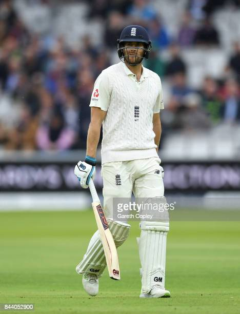 Dawid Malan of England leaves the field after being dismissed by Kemar Roach of the West Indies during day two of the 3rd Investec Test match between...