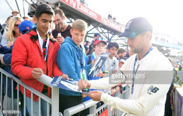 Dawid Malan of England meets fans after winning the Investec Test series between England and South Africa at Old Trafford on August 7 2017 in...