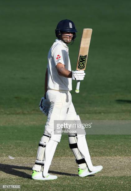 Dawid Malan of England raises his bat after reaching a half century during day 2 of the four day tour match between Cricket Australia XI and England...