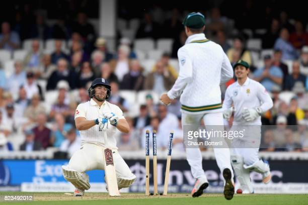 Dawid Malan of England reacts to being bowled out by Kagiso Rabada of South Africa during Day One of the 3rd Investec Test match between England and...