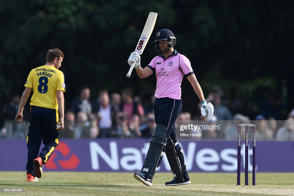 <a gi-track='captionPersonalityLinkClicked' href=/galleries/search?phrase=Dawid+Malan&family=editorial&specificpeople=4250352 ng-click='$event.stopPropagation()'>Dawid Malan</a> of Middlesex celebrates reaching his 50 during the NatWest T20 Blast between Middlesex and Hampshire at the Uckfield Sports Ground on May 27, 2016 in Uckfield, England.