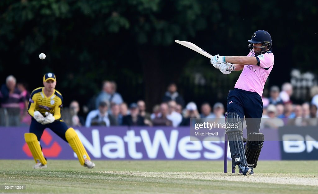 <a gi-track='captionPersonalityLinkClicked' href=/galleries/search?phrase=Dawid+Malan&family=editorial&specificpeople=4250352 ng-click='$event.stopPropagation()'>Dawid Malan</a> of Middlesex hits a boundary as wicketkeeper Adam Wheater of Hampshire looks on during the NatWest T20 Blast between Middlesex and Hampshire at the Uckfield Sports Ground on May 27, 2016 in Uckfield, England.