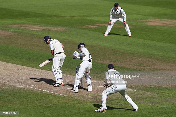 Dawid Malan of Middlesex is caught at first slip by Rikki Clarke of Warwickshire off the bowling of Josh Poysden during day one of the Specsavers...