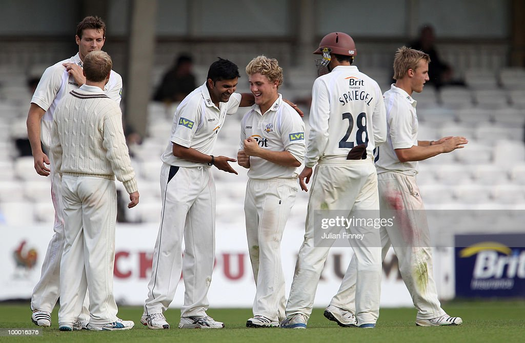 Dawid Malan of Middlesex is caught out by Laurie Evans off the bowling of Usman Afzaal of Surrey as Rory Hamilton-Brown congratulates during day four of the LV= County Championship Division Two match between Surrey and Middlesex at The Brit Oval on May 20, 2010 in London, England.
