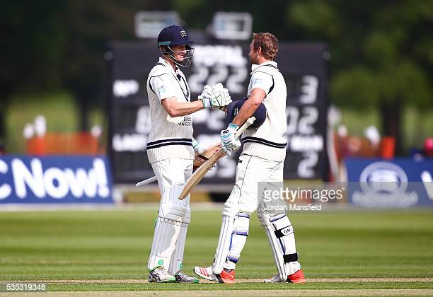 Dawid Malan of Middlesex is congratulatd by Adam Voges of Middlesex after he reaches his century during day one of the Specsavers County Championship...