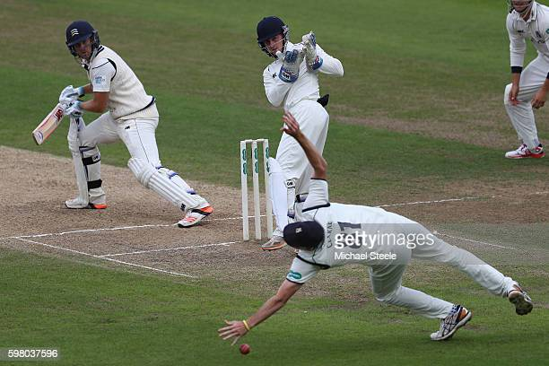 Dawid Malan of Middlesex survives a chance as Rikki Clarke of Warwickshire at first slip fails to take a sharp chance off the bowling of Jeetan Patel...