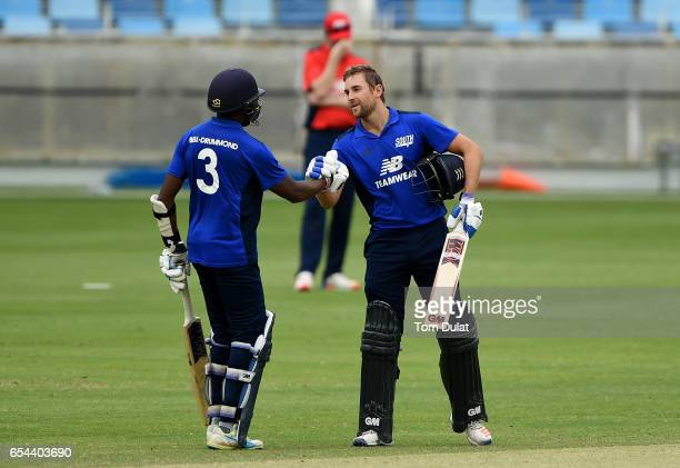 Dawid Malan of The South celebrates a century during Game One of the ECB North versus South Series at Dubai International Cricket Ground on March 17...
