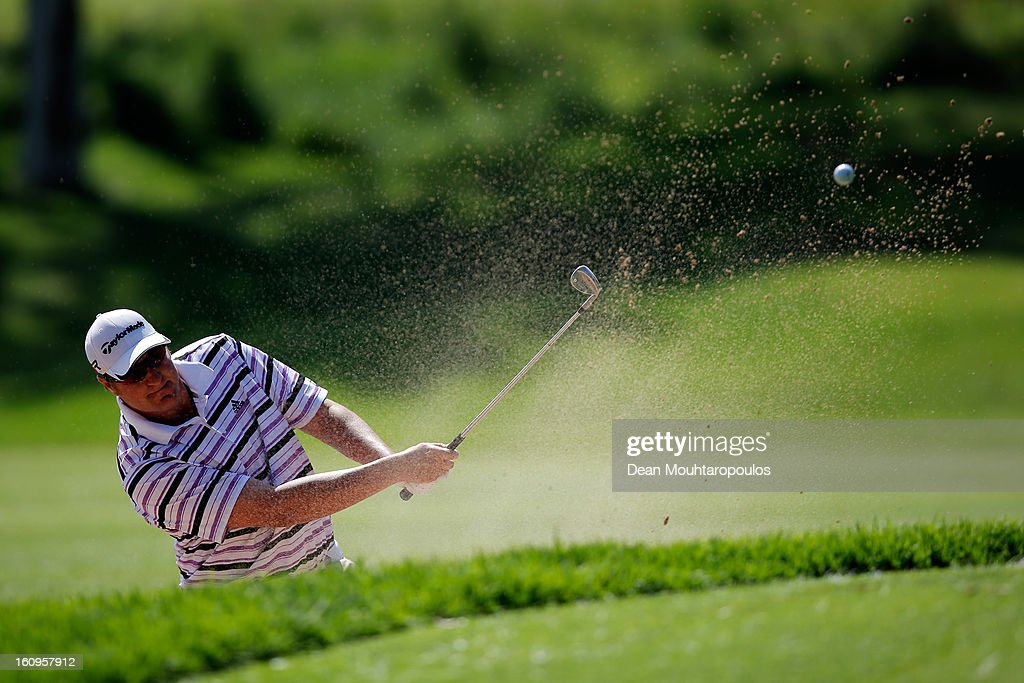 Dawie Van Der Walt of South Africa hits his third shot on the 2nd hole during Day Two of the Joburg Open at Royal Johannesburg and Kensington Golf Club on February 8, 2013 in Johannesburg, South Africa.