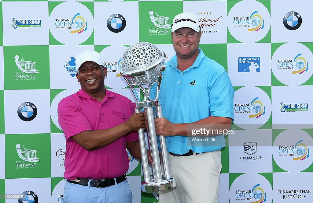Dawie Van Der Walt of South Africa is presented the trophy by Tshwane's executive mayor, Kgosientso Ramokgopa after winning the Tshwane Open at Copperleaf Golf & Country Estate on March 3, 2013 in Centurion, South Africa.