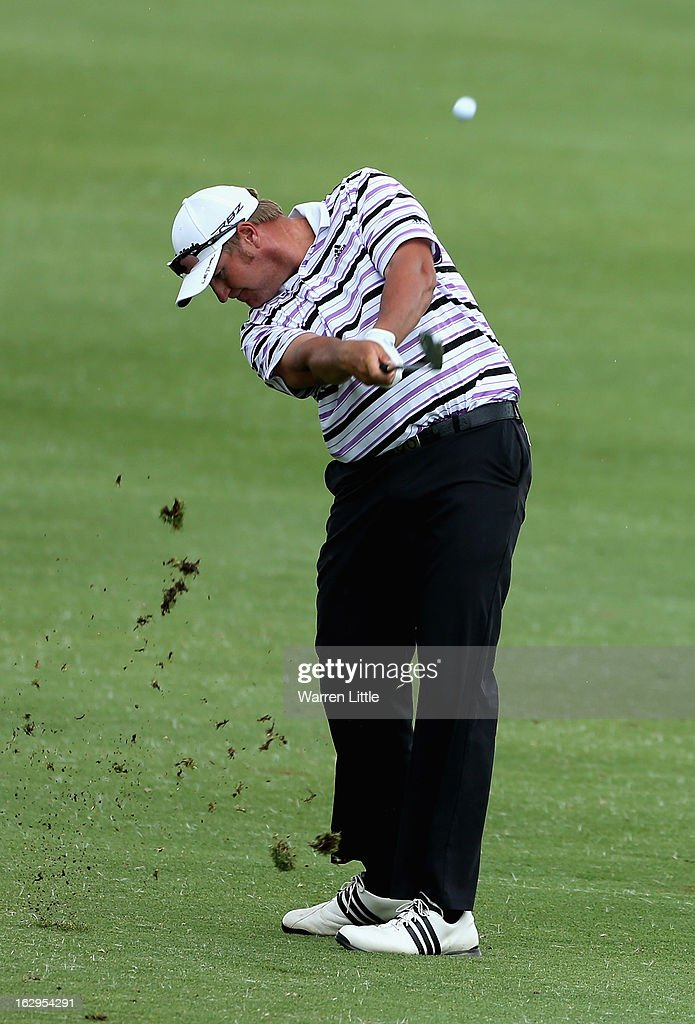 Dawie Van Der Walt of South Africa plays his second shot into the 15th green during the third round of the Tshwane Open at Copperleaf Golf & Country Estate on March 2, 2013 in Centurion, South Africa.