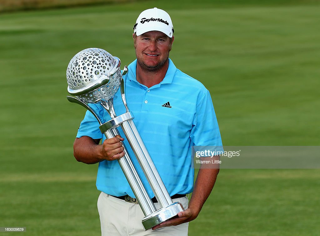 Dawie Van Der Walt of South Africa poses with the trophy after winning the Tshwane Open at Copperleaf Golf & Country Estate on March 3, 2013 in Centurion, South Africa.