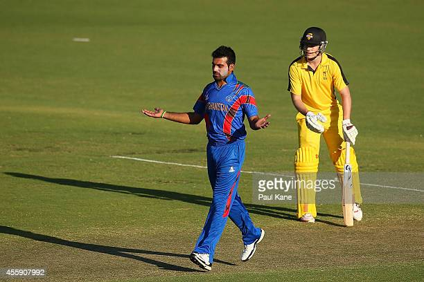 Dawlat Khan of Afghanistan celebrates after dismissing Marcus Harris of the WA XI during the One Day tour match between the Western Australia XI and...