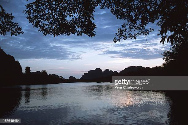 Dawn breaks over a river inside the Phong Nha Nature Reserve seen in the background The Vietnamese Government is proposing that this Nature Reserve...